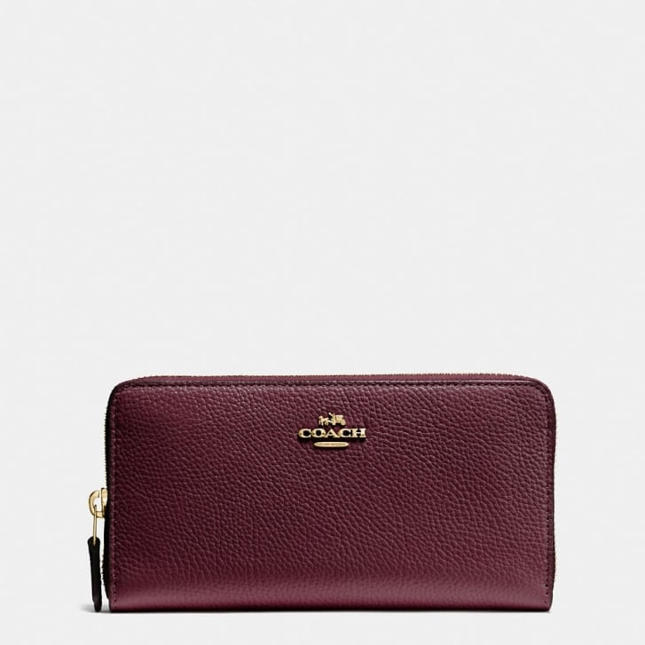 COACH Accordion Zip Pebble Leather Purse in Oxblood